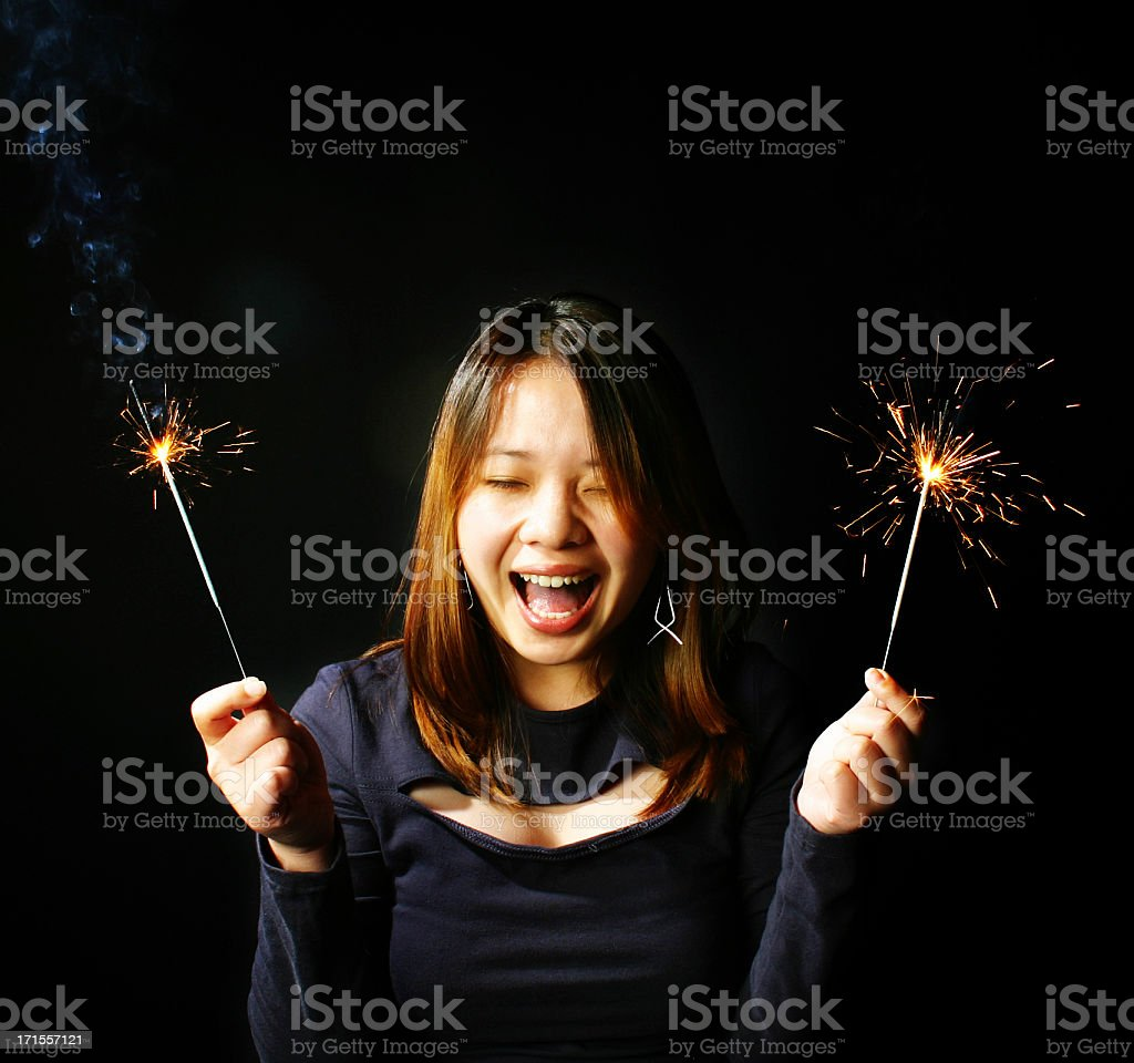 Asian female with sparklers royalty-free stock photo