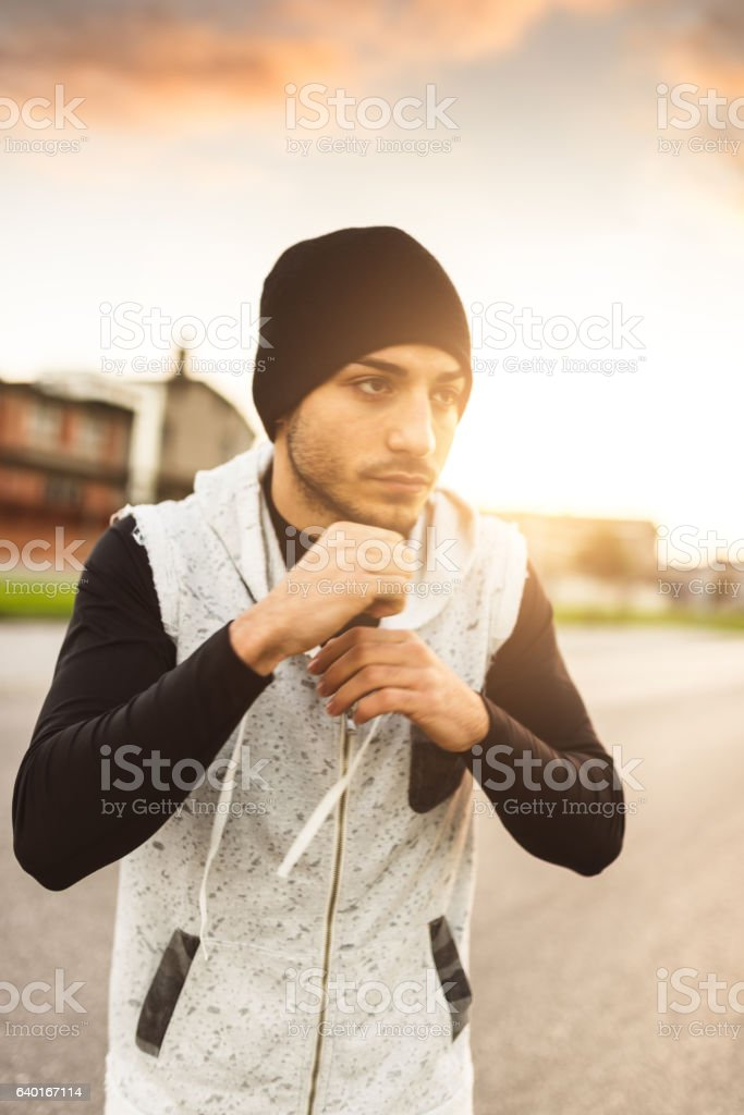 asian fighter man doing a punching boxing training stock photo