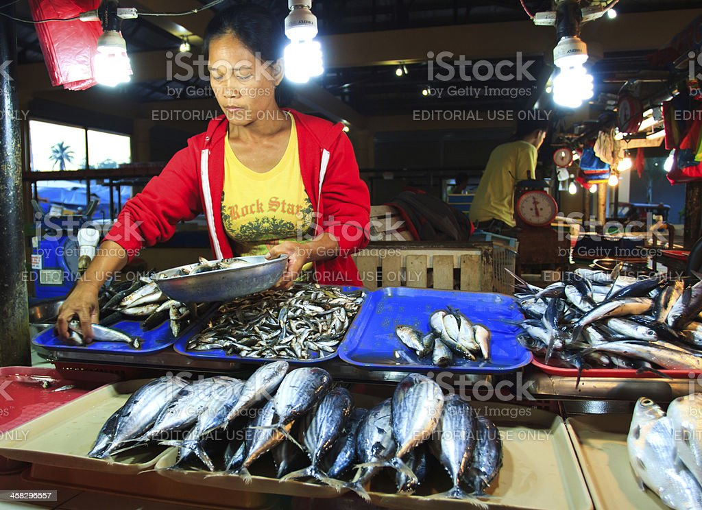 Asian fish vendor royalty-free stock photo