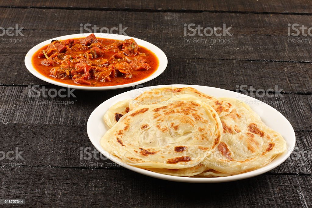 Asian flat bread paratha with meat curry stock photo