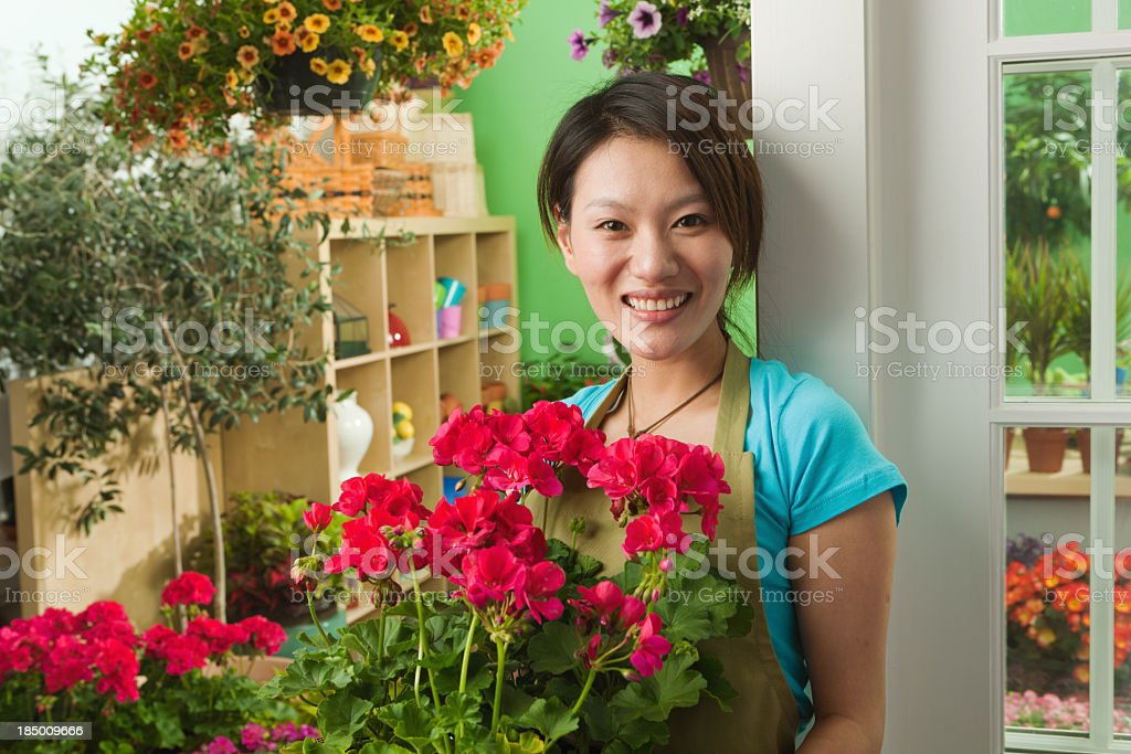 Asian Flower Shop Small Business Owner in Front of Store royalty-free stock photo