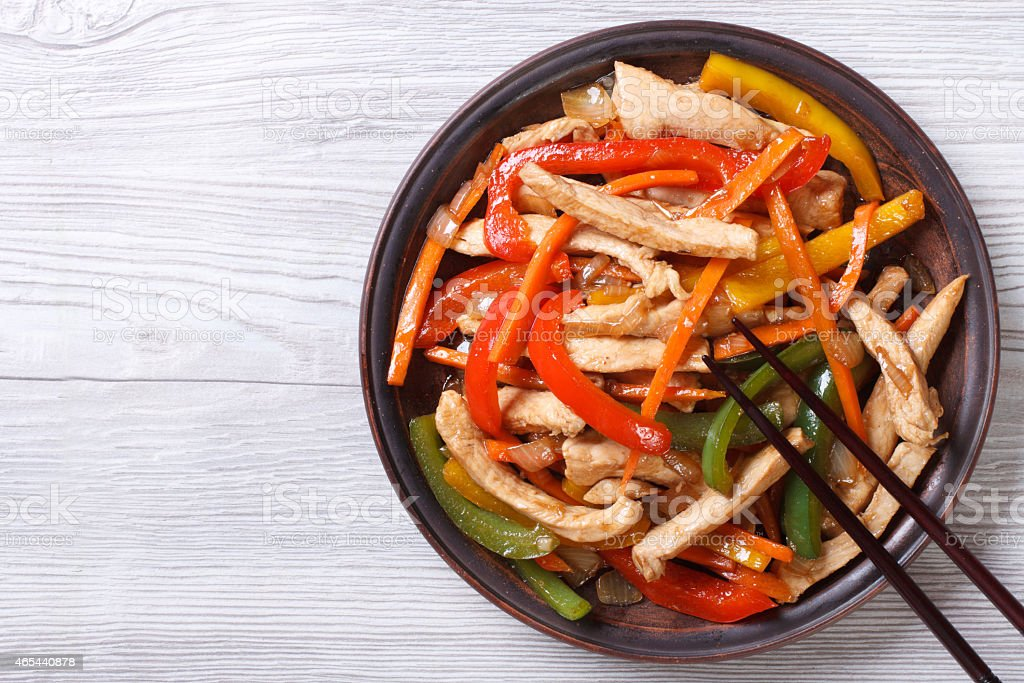 Asian food: chicken in sweet and sour sauce with vegetables stock photo