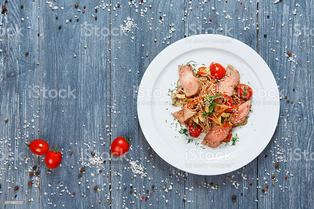 Asian food. Fried thai rice noodles with veal meat stock photo