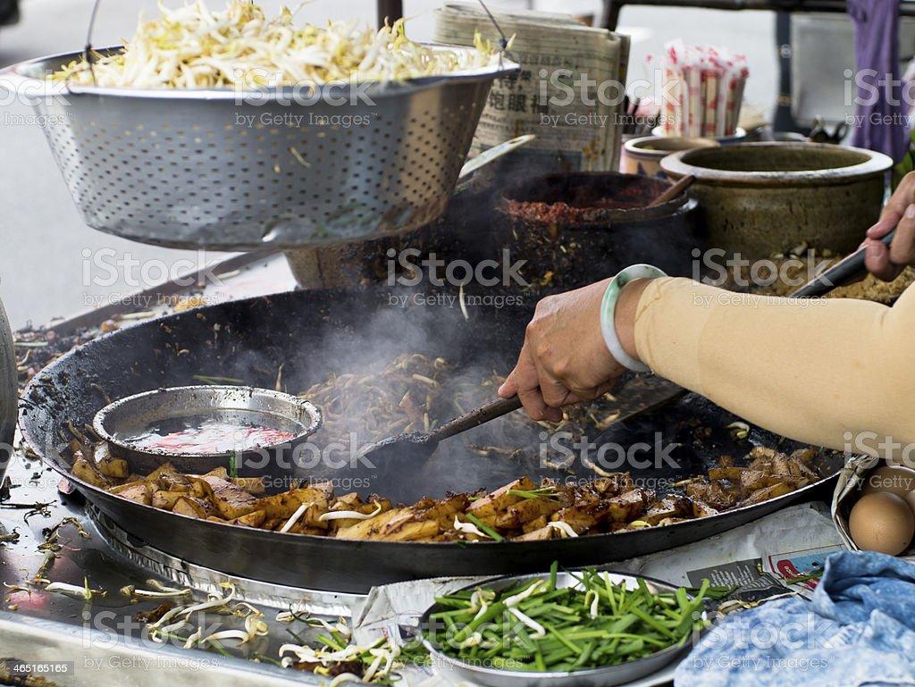 Asian Food Market - Frying Carrot Cake stock photo