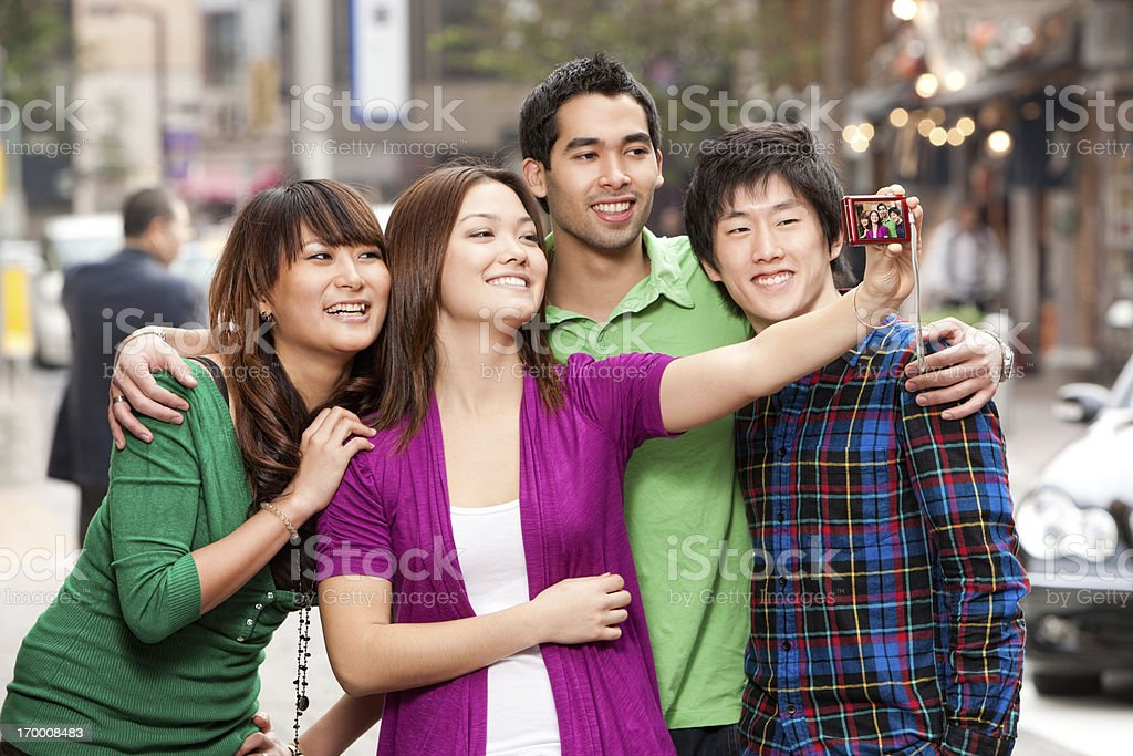Asian Friends Taking Self Portrait royalty-free stock photo
