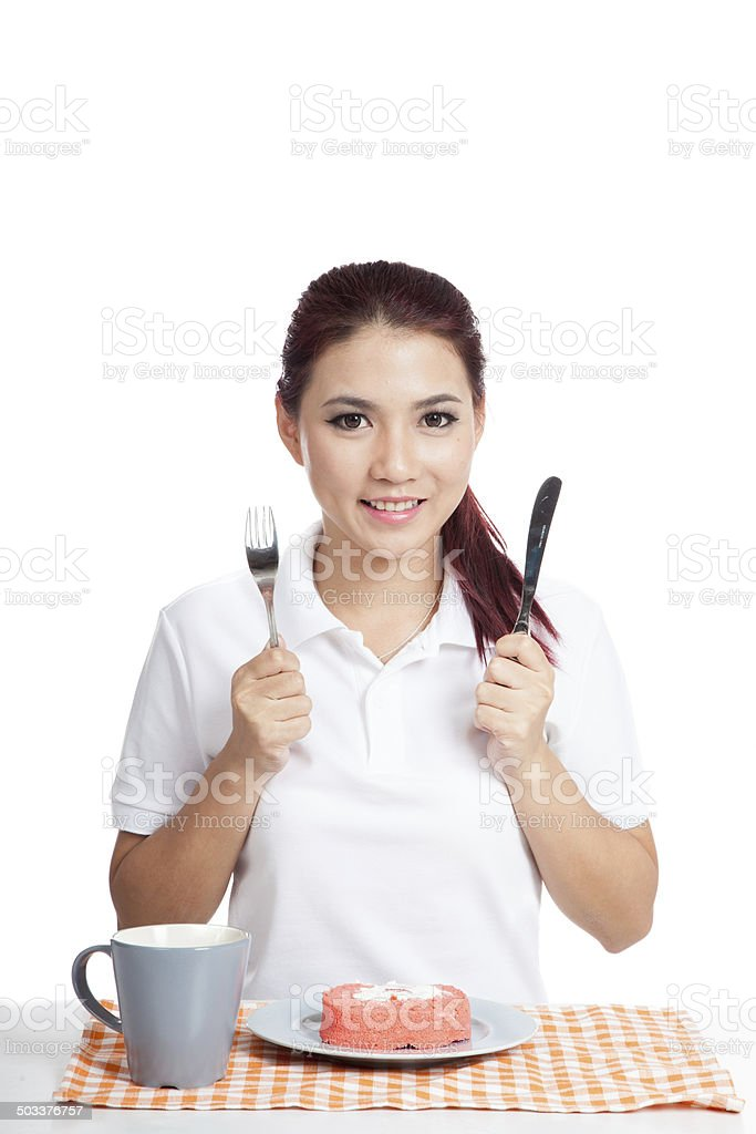 Asian girl about to eat strawberry cake and smile stock photo
