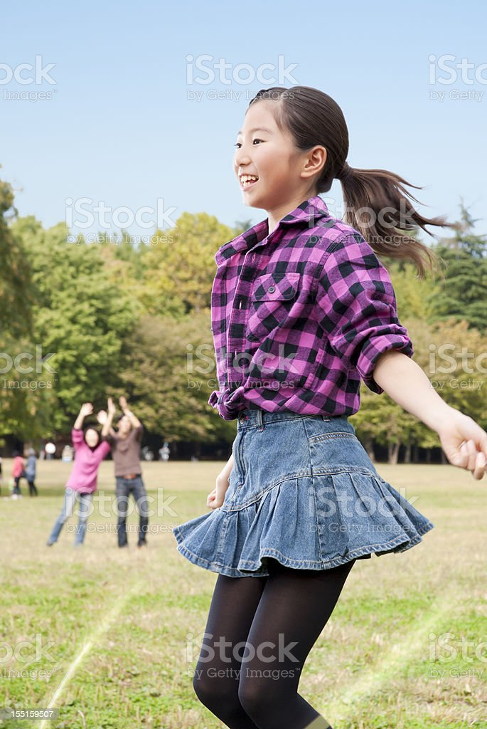 Asian girl and family with a jump rope royalty-free stock photo