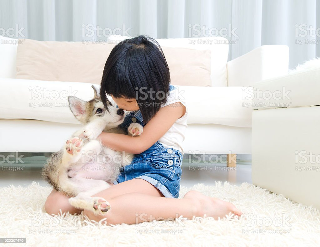Asian girl and pet royalty-free stock photo