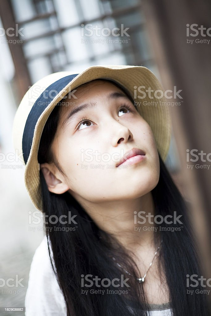 Asian girl and wood window royalty-free stock photo
