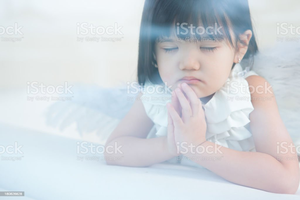 Asian girl angel praying royalty-free stock photo