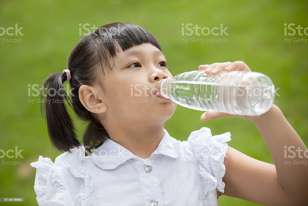 Asian girl drink with plastic bottle stock photo