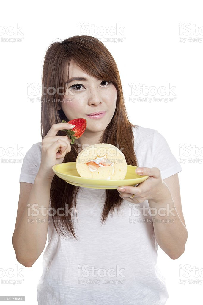 Asian girl eat strawberry and  roll cake stock photo