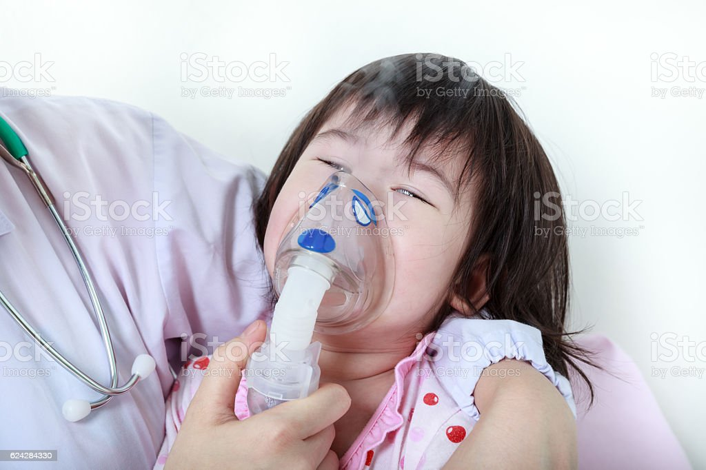 Asian girl having respiratory illness helped by doctor. stock photo