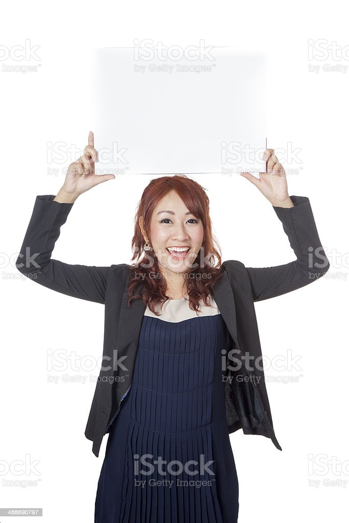 Asian  girl hold a blank sign over her head stock photo