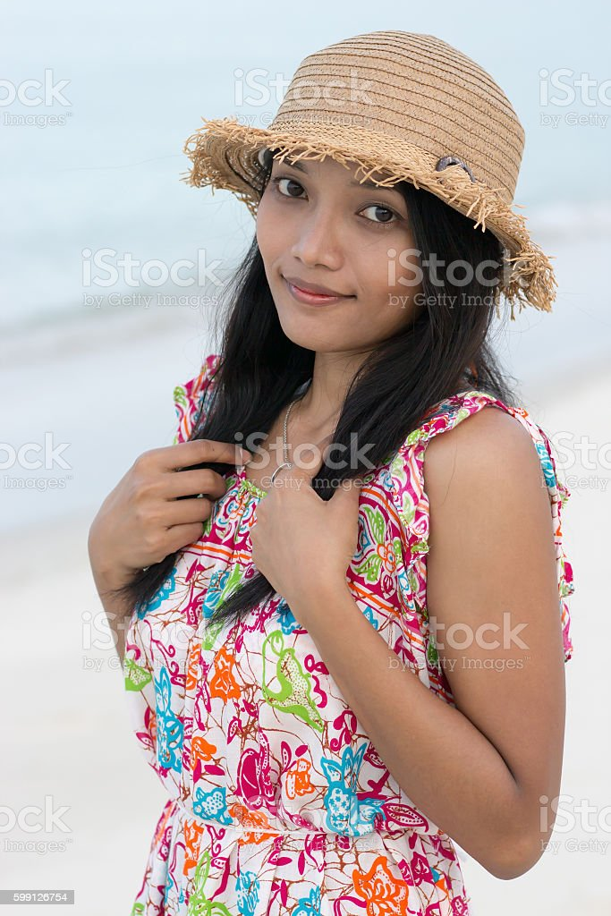 Asian girl in a straw hat stock photo
