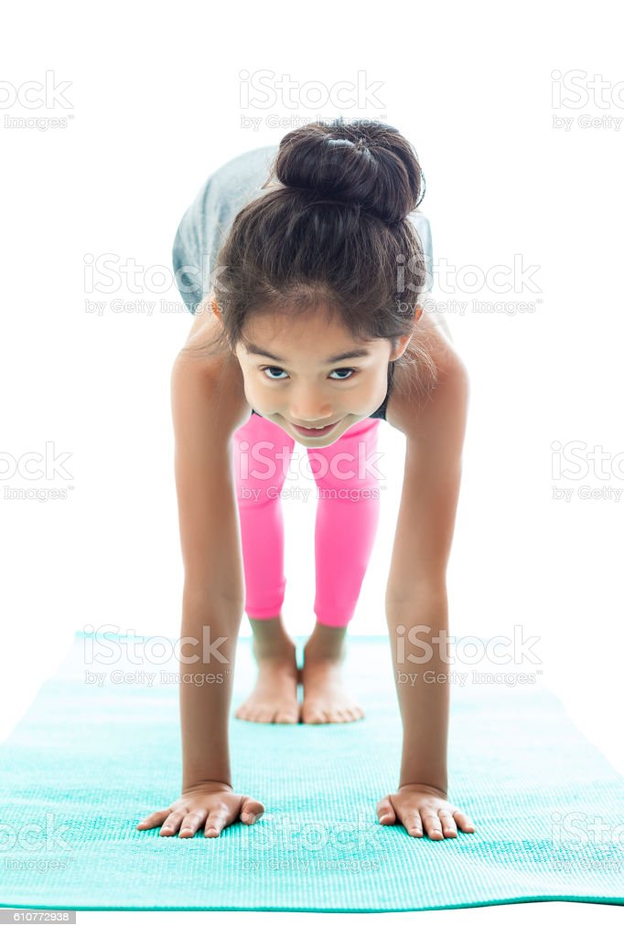 Asian girl in a yoga pose stock photo
