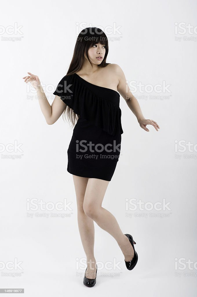 Asian girl in black clubbing dress dancing royalty-free stock photo