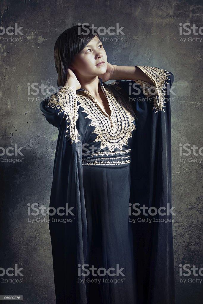 Asian girl in dark blue robe. royalty-free stock photo
