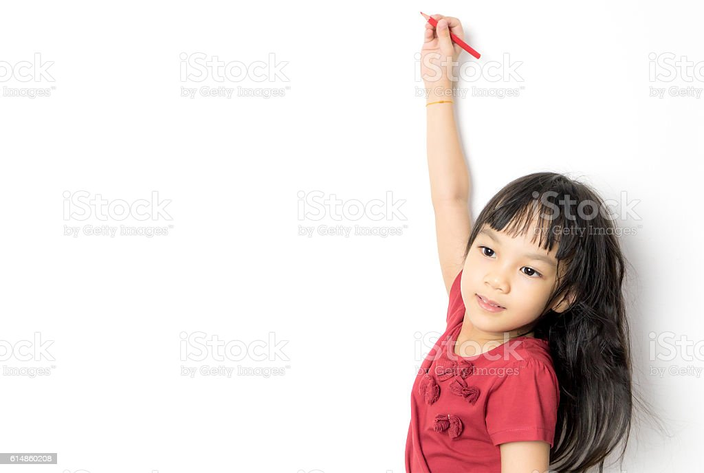 Asian girl is writing on a white copy space stock photo