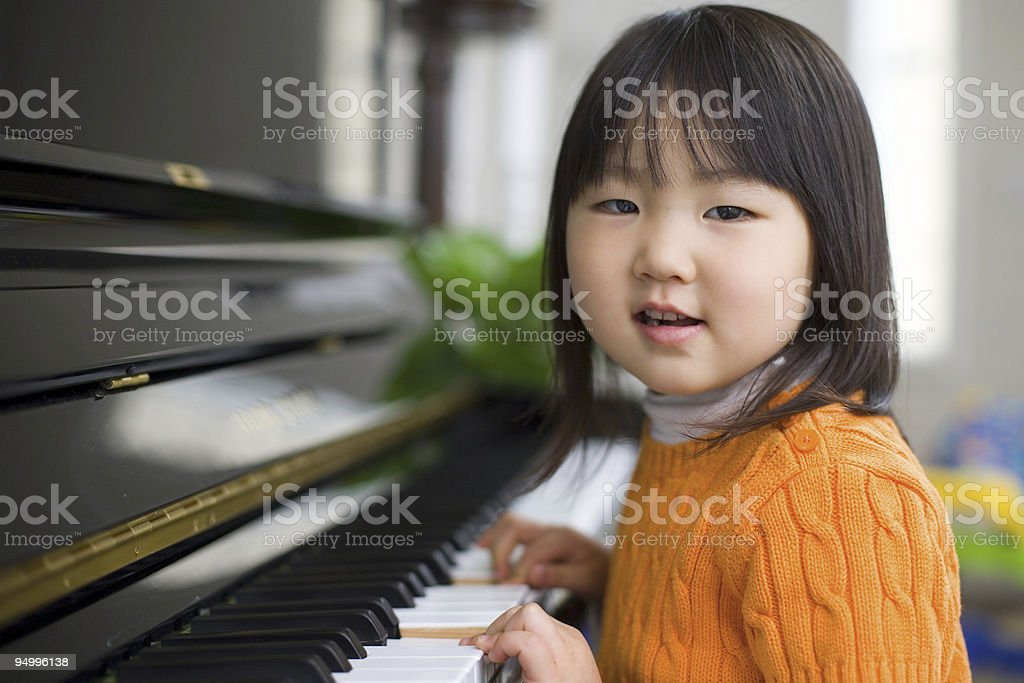 Asian Girl Learning Piano royalty-free stock photo