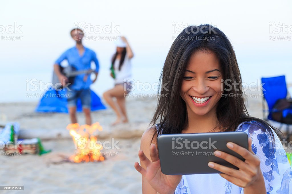 Asian girl looking pictures at her smart phone stock photo