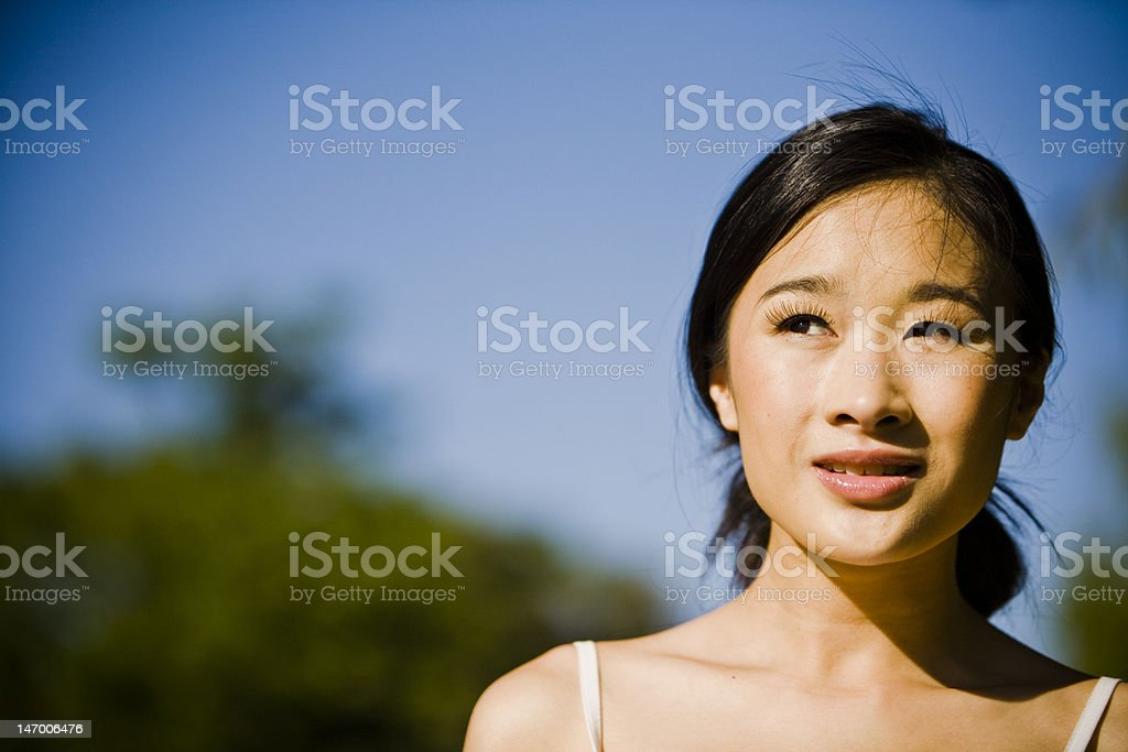 Asian girl looking torwards future royalty-free stock photo