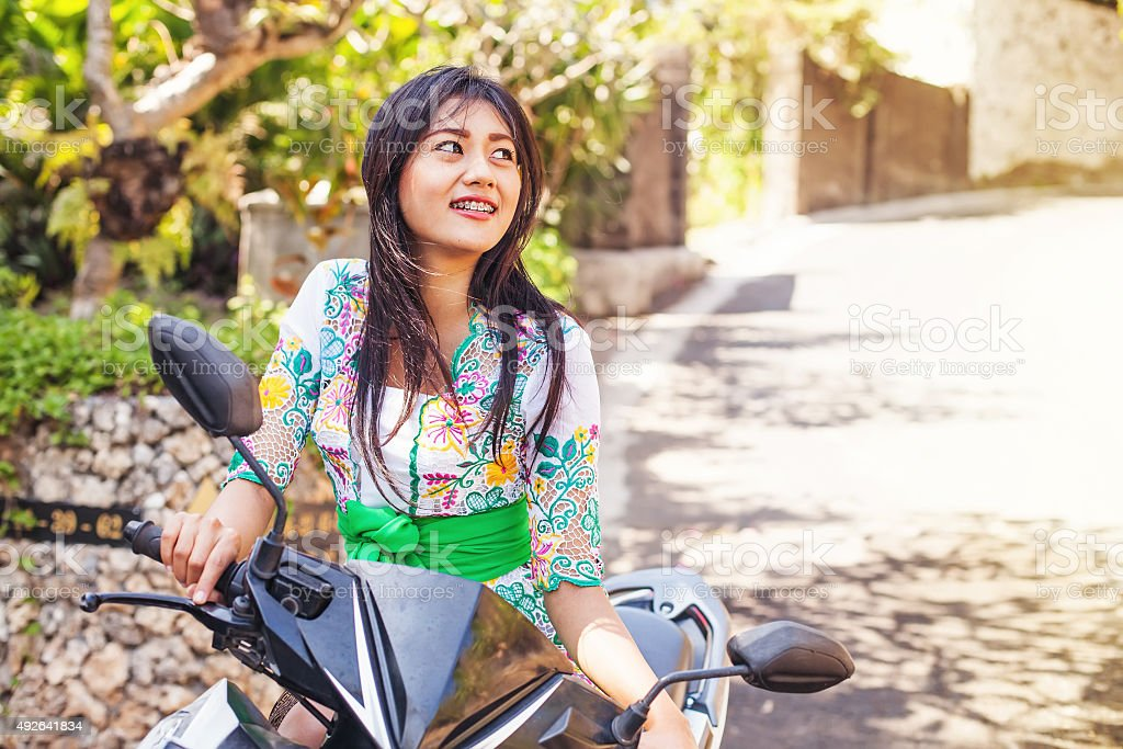 Asian girl on a motorbike stock photo