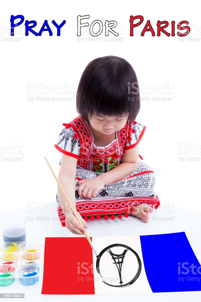 Asian girl painting Eiffel Tower logo. Pray for Paris. stock photo