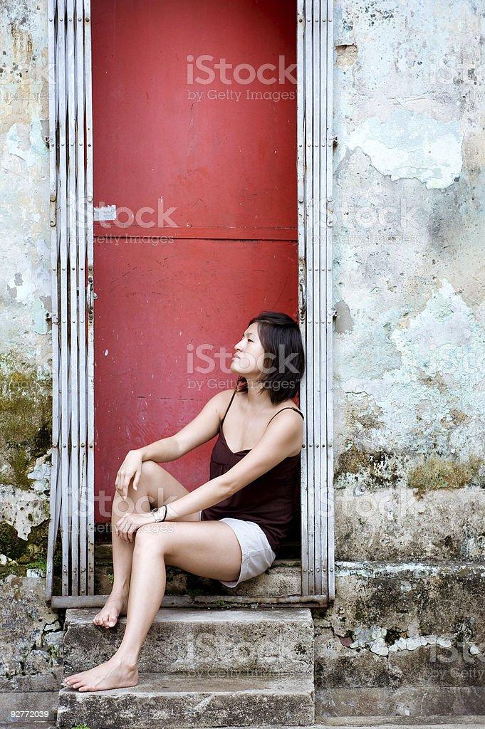 Asian girl red door royalty-free stock photo