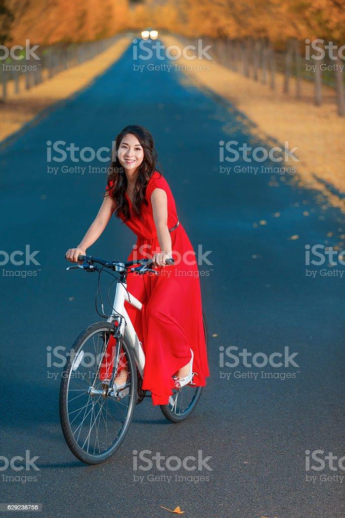 Asian Girl Ride a Bike and Enjoying at Napa Valley stock photo