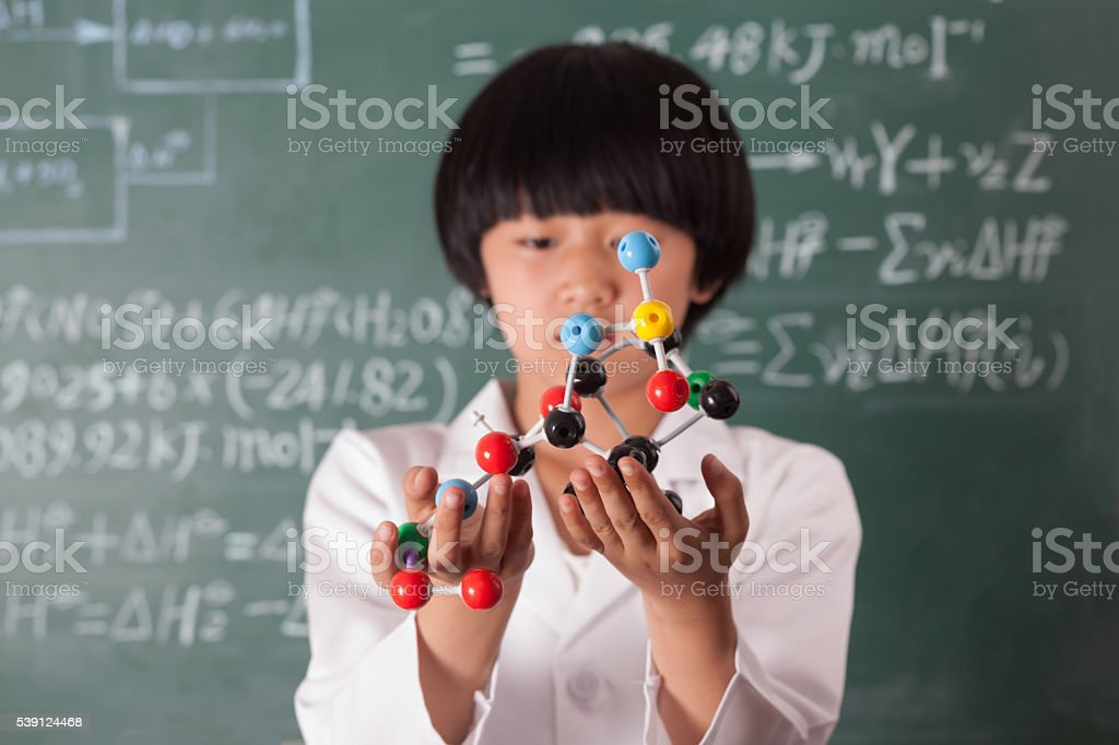 asian girl standing in front of chalk board stock photo