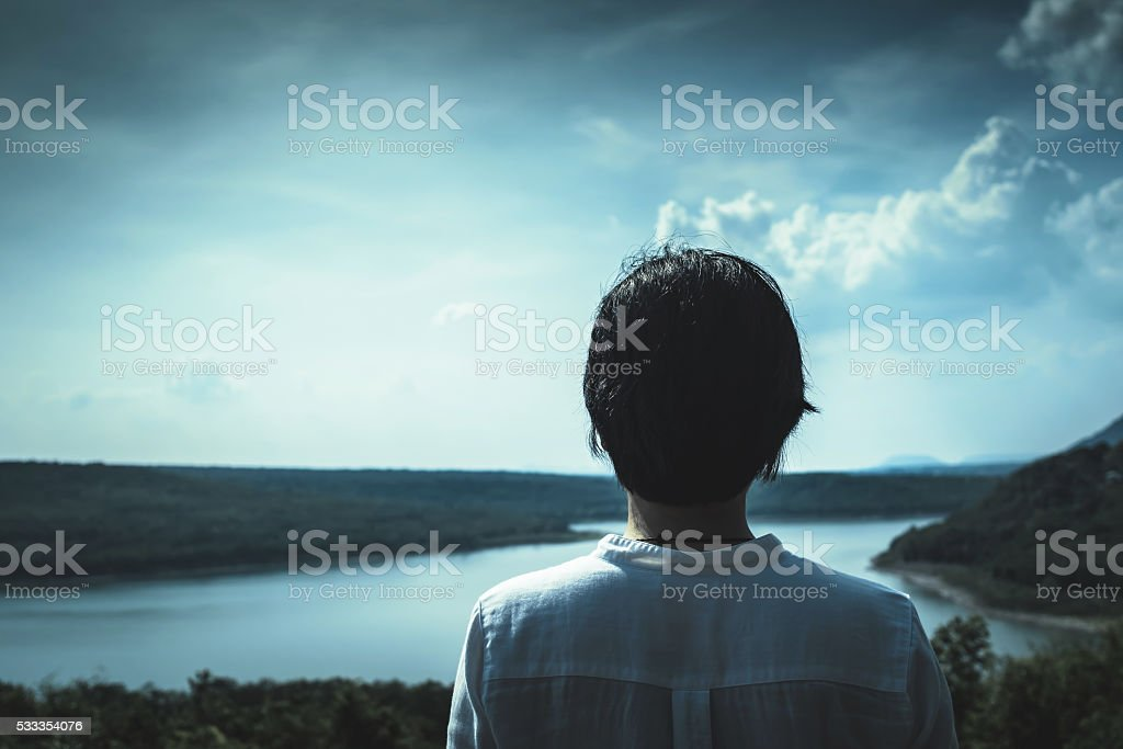 Asian girl standing on top of the mountain stock photo