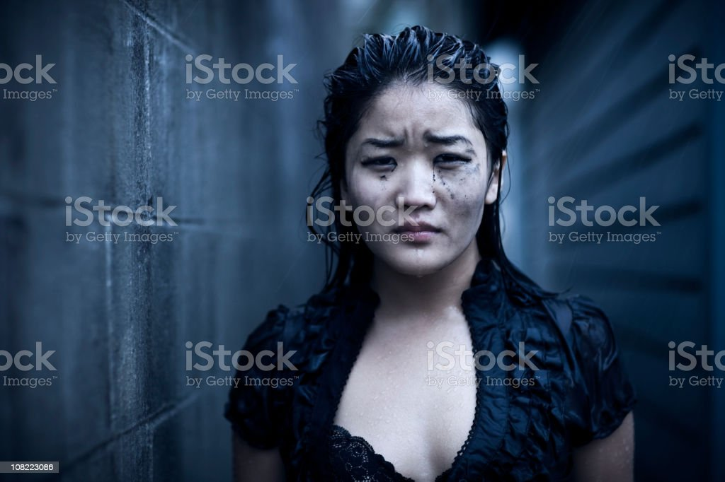 Asian Young Woman Portrait, Wet and Crying in Rain, Copyspace royalty-free stock photo