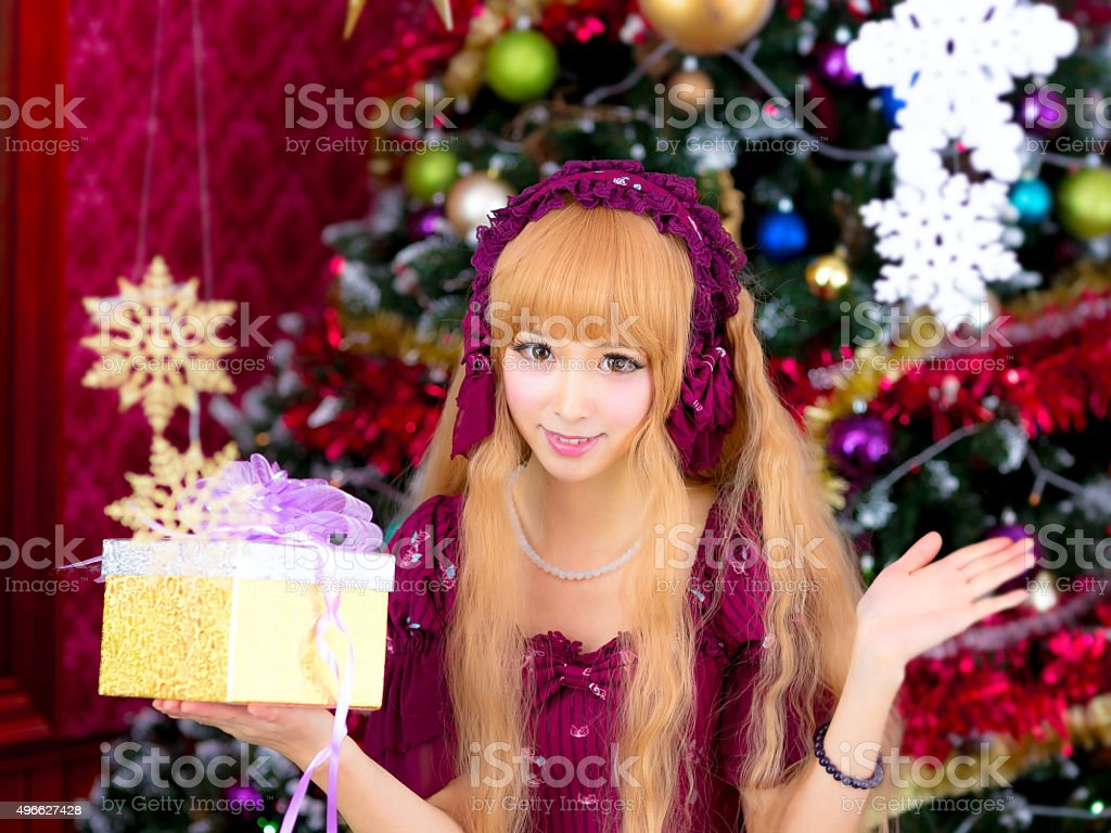asian girl sweet Christmas tree with gift box stock photo