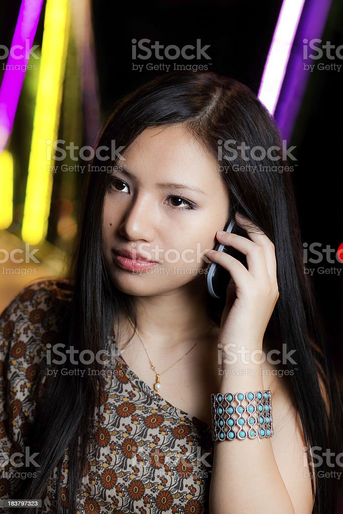 Asian Girl Talking on the phone royalty-free stock photo