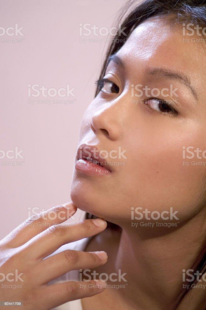 Asian Girl Touching Her Face stock photo