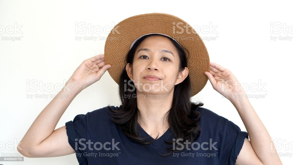 Asian girl wearing hat and casual shirt, smile and happy stock photo