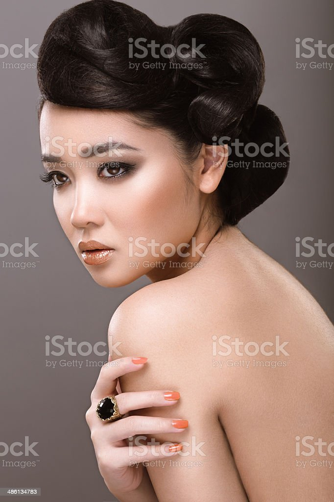 Oriental girl with evening hairstyle stock photo