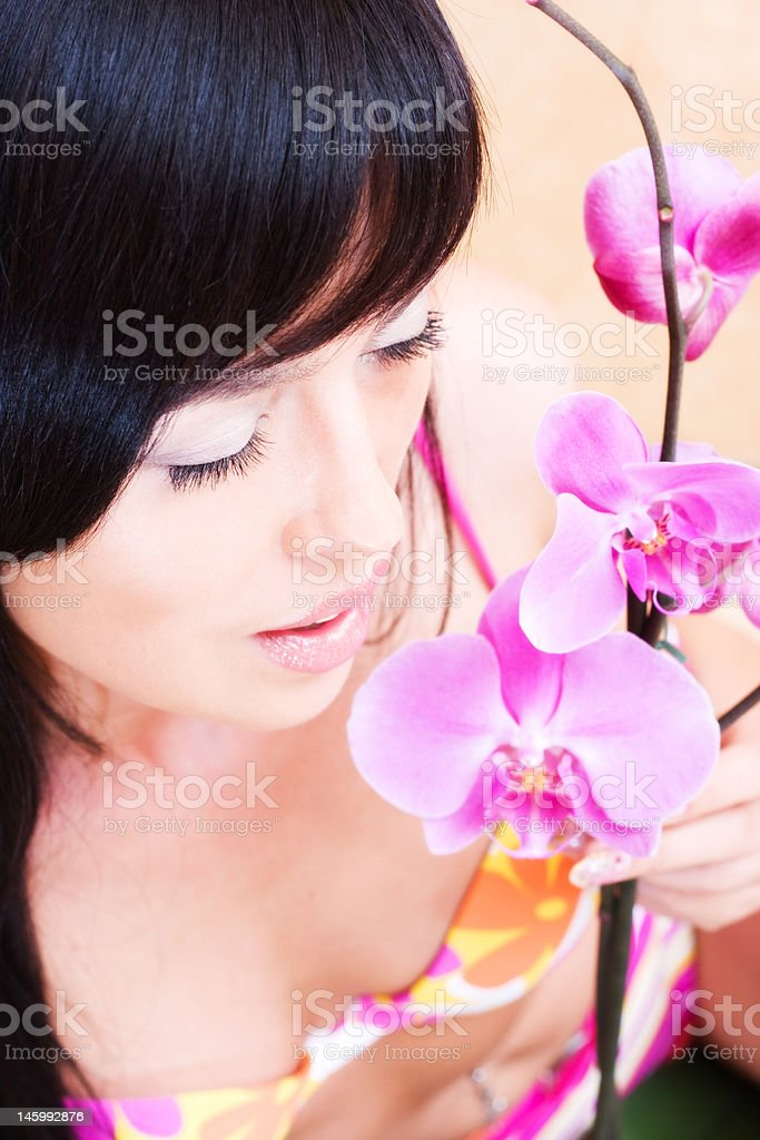 Asian girl with orchid royalty-free stock photo