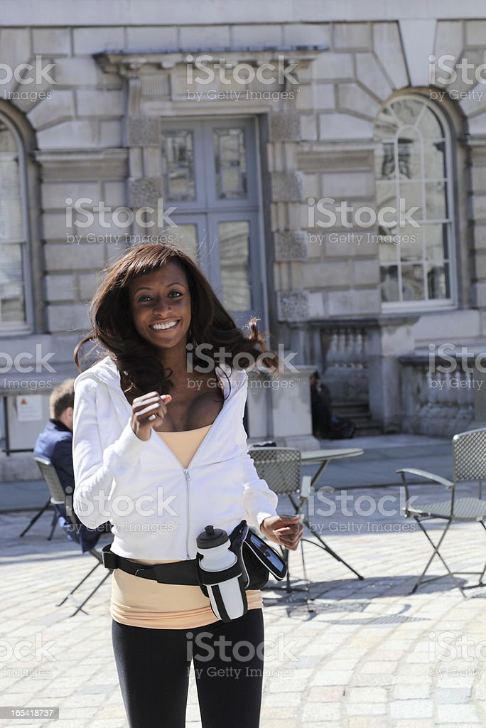 asian girl with white top jogs in london sun stock photo