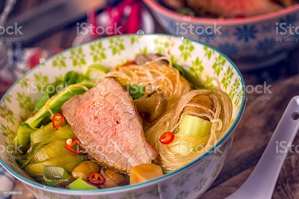 Asian Glass Noodle Soup with Beef and Pak Choi stock photo