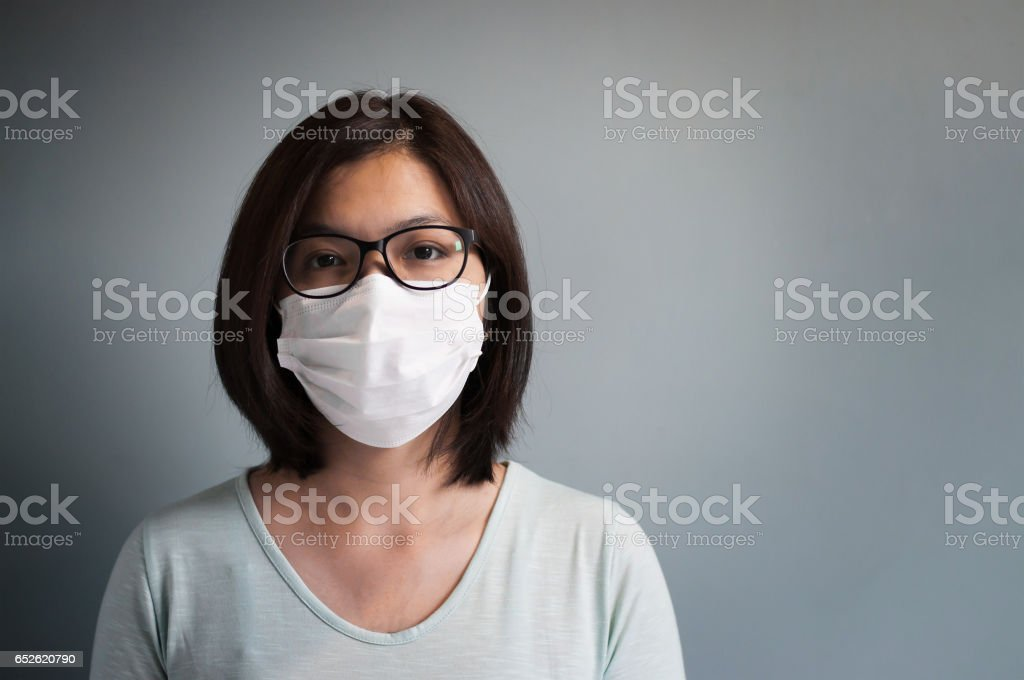 Asian glasses woman wear medical mask with copy space. stock photo