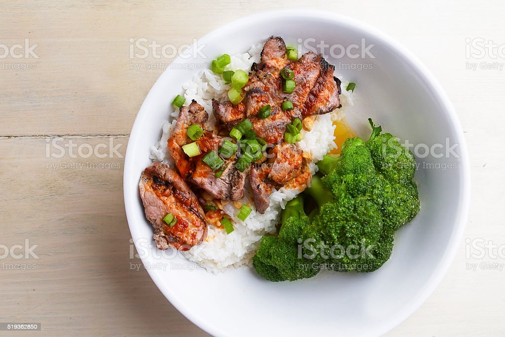 Asian grill beef rice bowl and steam brocolli stock photo