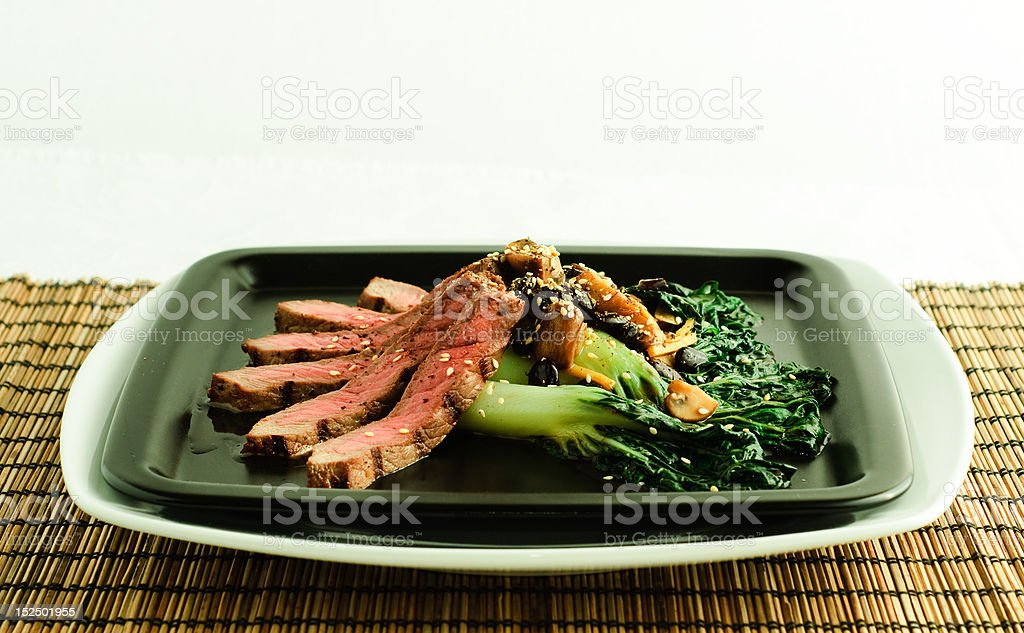 Asian grilled steak with bok choy royalty-free stock photo