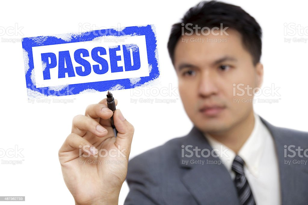 Asian handsome businessman write 'PASSED' royalty-free stock photo