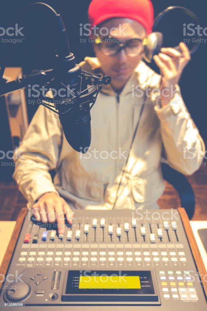 asian handsome DJ working in radio broadcasting studio stock photo
