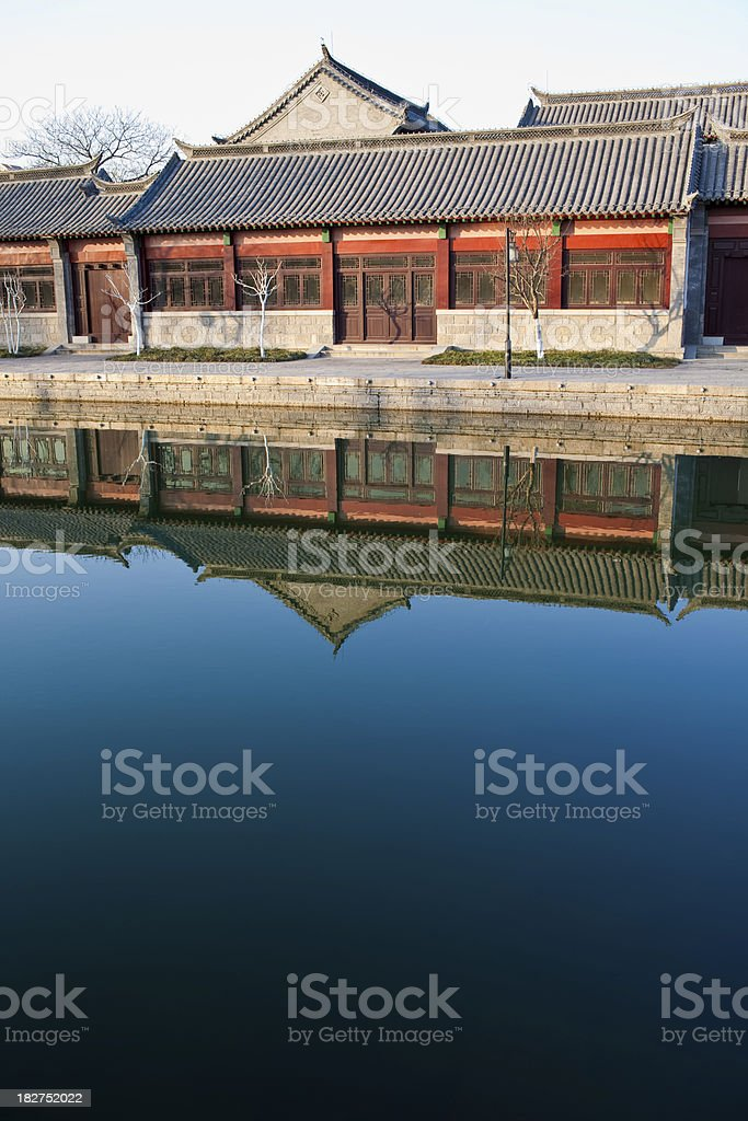 Asian house by the water stock photo