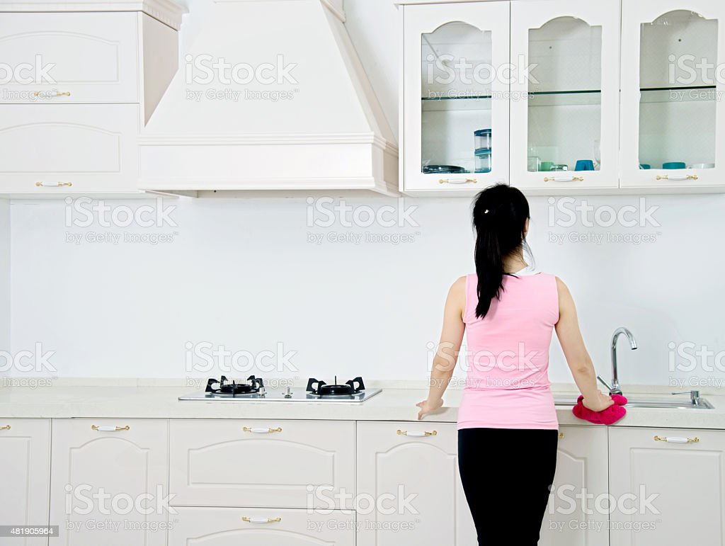 Asian housewife cleaning the kitchen stock photo