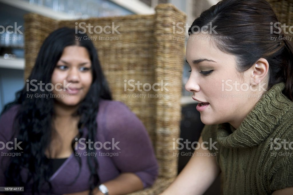 Asian Indian and Caucasian Friends Talking in Coffee Shop royalty-free stock photo