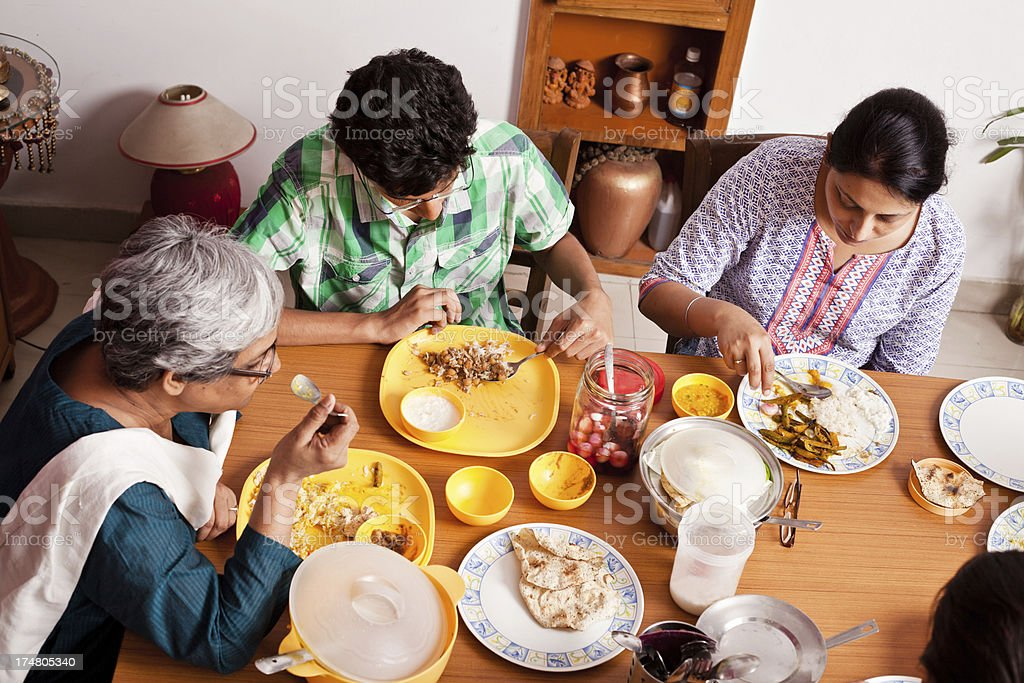 Asian Indian Family Enjoying Meal Together royalty-free stock photo